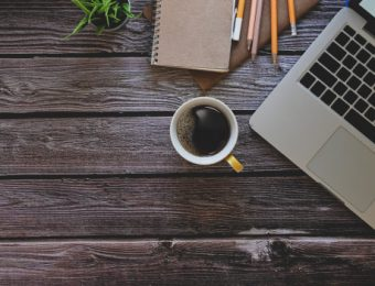 laptop-computer-notebook-pencil-with-coffee-plant-wooden-table_35674-2265.jpg