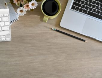 top-office-wood-table-with-cup-coffee-notebook-pencil-laptop-copy-space_67155-795.jpg